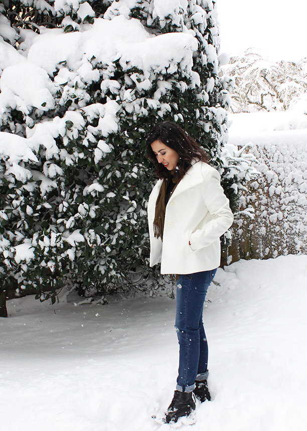 White Winter Coat and Distressed Jeans