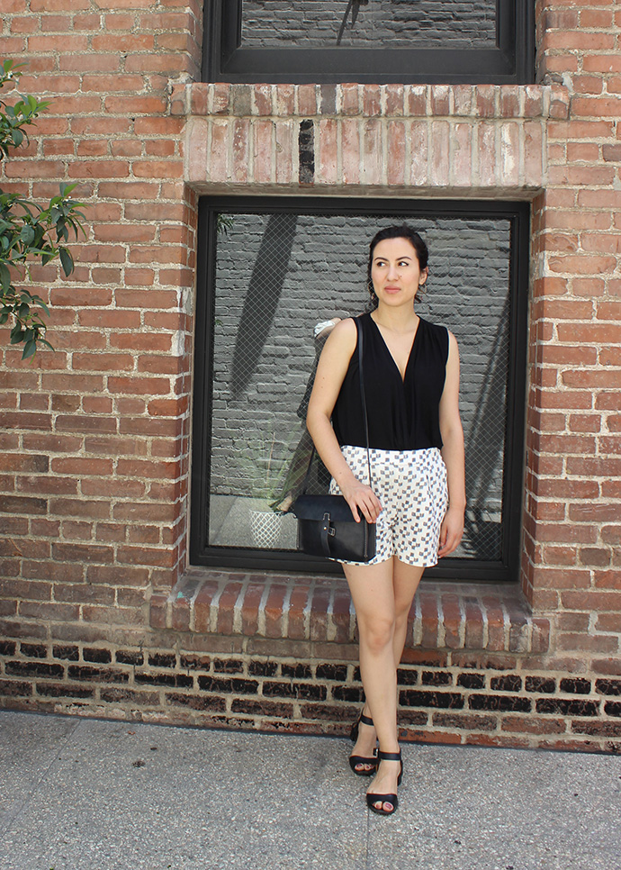 Summer Minimalist Style: Black Surplice Top, Ikat Print Shorts, and Black Sandals